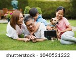 family are taking a selfie with ... | Shutterstock . vector #1040521222