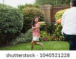 little girl is having a water... | Shutterstock . vector #1040521228