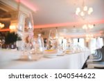 empty glasses on table at... | Shutterstock . vector #1040544622