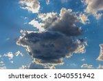 A Group Of Cumulus Clouds...