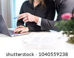 boss giving instructions and... | Shutterstock . vector #1040559238