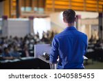professional man on stage... | Shutterstock . vector #1040585455