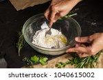 women's hands mixing dough with ...   Shutterstock . vector #1040615002