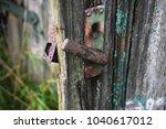 decay door hnadle  | Shutterstock . vector #1040617012