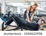 attractive fitness girl... | Shutterstock . vector #1040622958
