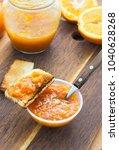 orange jam in bowl with toast...   Shutterstock . vector #1040628268