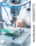 Small photo of soldering iron tips of automated manufacturing soldering and assembly pcb board