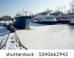 frozen river ships in ice | Shutterstock . vector #1040662942