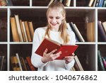 teenage girl in a library | Shutterstock . vector #1040676862