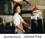 Stock photo beautiful young asian woman making a coffee cup in cafe 1040687998