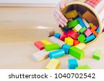 child playing with colorful... | Shutterstock . vector #1040702542