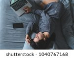 woman lay on bed with gray... | Shutterstock . vector #1040767168