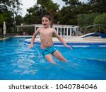 little boy having fun playing... | Shutterstock . vector #1040784046