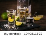 gold tequila shot with lime and ... | Shutterstock . vector #1040811922