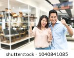 happy asian couple with thumb... | Shutterstock . vector #1040841085