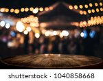 empty wooden table in front of... | Shutterstock . vector #1040858668