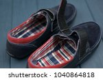 dark blue suede moccasins with... | Shutterstock . vector #1040864818