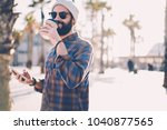 positive hipster guy in hat and ... | Shutterstock . vector #1040877565