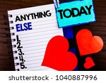 Small photo of Announcement text showing Anything Else. Concept meaning Ask Asking Question to Have Answer written notebook book paper the wooden background Today Love Heart.