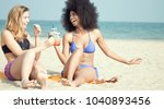 two girls best friends on beach ... | Shutterstock . vector #1040893456