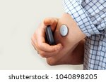 man testing glucose level with...   Shutterstock . vector #1040898205