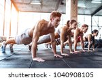 group of sporty muscular people ... | Shutterstock . vector #1040908105