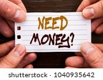 Small photo of Handwritten text sign showing Need Money Question. Business concept for Economic Finance Crisis, Cash Loan Needed written Sticky Note Paper Holding Hand with Finger.