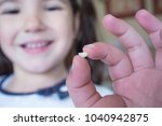 little 5 years old girl showing ... | Shutterstock . vector #1040942875