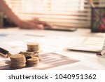 stack coin money with report... | Shutterstock . vector #1040951362