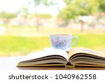 close up of open book lying on... | Shutterstock . vector #1040962558
