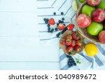 the fruit on the white wood... | Shutterstock . vector #1040989672