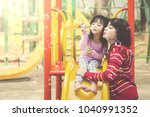 mother and daughter play soap... | Shutterstock . vector #1040991352