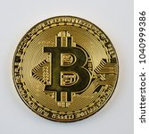 bitcoin isolated on white... | Shutterstock . vector #1040999386