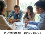 vietnamese young man explainig... | Shutterstock . vector #1041015736