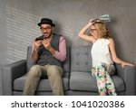Small photo of Couple fight after caught looking at cell phone, cheating, ignoring, addicted to cellphone