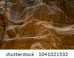 the wall of al siq  petra ... | Shutterstock . vector #1041021532