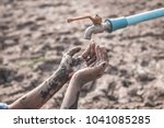 the cracked dry ground due to... | Shutterstock . vector #1041085285