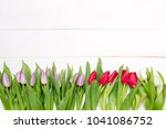bouquet of tulips on a table... | Shutterstock . vector #1041086752