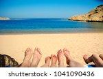 a nice family feet on the sand... | Shutterstock . vector #1041090436