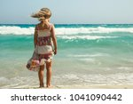 little nice girl   on the beach ... | Shutterstock . vector #1041090442