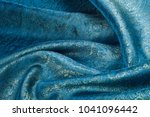 Small photo of Background texture, pattern. Blue paisley silk chiffon mod fabric by the yard. Crinkled, flowy, soft, very light
