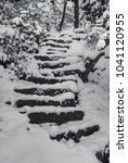 snow covered stone steps on the ... | Shutterstock . vector #1041120955