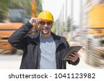 construction worker posing with ... | Shutterstock . vector #1041123982