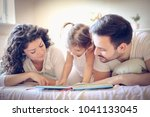 mommy and daddy reading me a... | Shutterstock . vector #1041133045