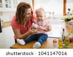 mother and daughter kid... | Shutterstock . vector #1041147016