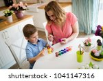 mother and son paint easter eggs | Shutterstock . vector #1041147316