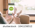 filing taxes online using... | Shutterstock . vector #1041158512