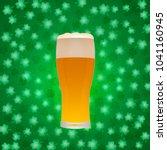 glass of beer on green shamrock ... | Shutterstock .eps vector #1041160945