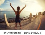 girl with arms outstretched at... | Shutterstock . vector #1041190276
