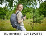 young woman with backpack | Shutterstock . vector #1041192556